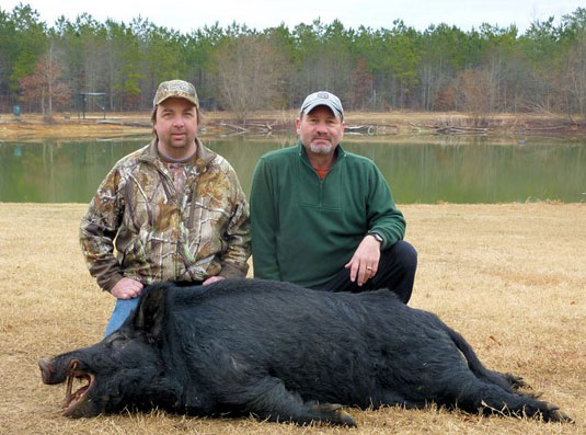Author and Buddy, Don, pose with Don's 260+ pound boar..