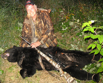Randy, Randy's black bear and Savage 10ML-II rifle.